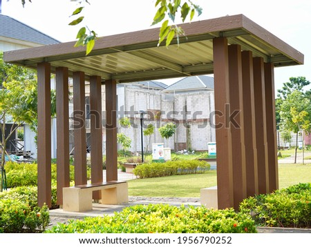 Wooden shelter or hut in the park with bench park. Photo stock ©