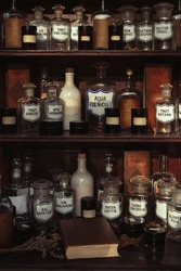 Wooden shelves with old bottles in an old retro apothecary shop