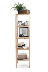 Wooden shelving unit with different items isolated on white
