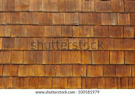 Wooden shingles - Wooden shingles arranged like scales make an excellent background.