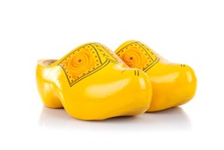 Wooden shoes, traditional dutch footwear for farmers, isolated on white background
