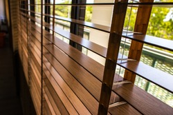 Wooden shutters blinds (Windows blinds) with the light sunshine
