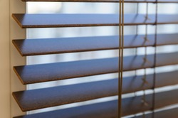 Wooden shutters on the window in the living room.