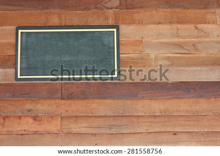Wooden sign board blank frame on wood wall.