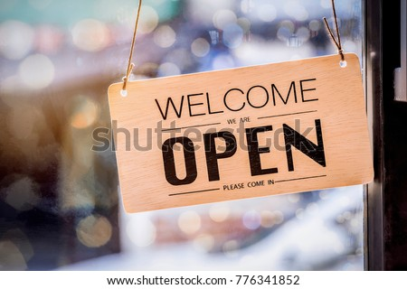 Wooden sign board hanging on door of cafe #776341852