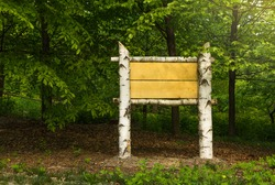 wooden sign board ready to put information in the woods