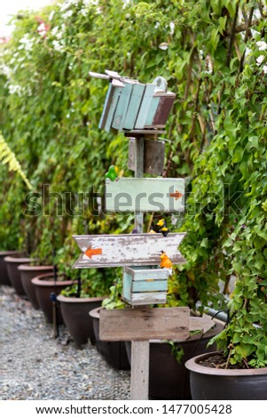 Wooden Sign Post  with arrow pointers in the garden #1477005428