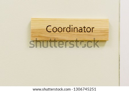 Wooden sign with the word Coordinator #1306745251