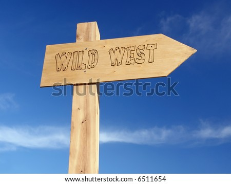 Wooden signpost indicating Wild West direction over blue sky