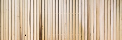 Wooden slats on floor or wall in vertical parallel pattern, background panel texture, horizontal image