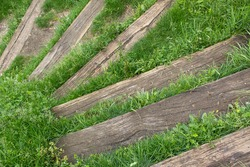 Wooden spiral down steps of old stairs  on the nature and green  grass life path walk way concept