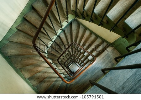 Wooden spiral staircase in an old parisian building (high angle view)