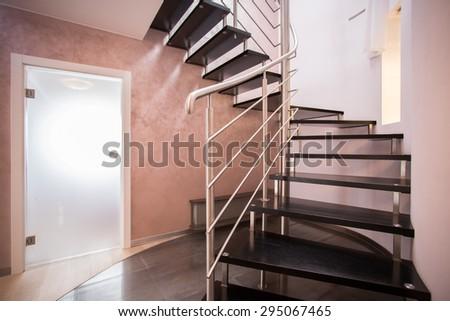 Wooden spiral stairs in luxury modern house