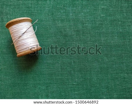 wooden spools on green background #1500646892