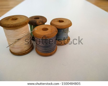 wooden spools on white background #1500484805