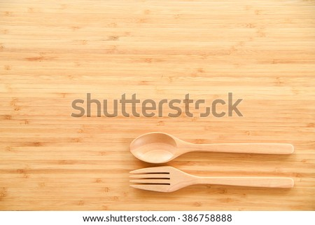 Kitchen Table Background wooden spoon and fork on wood texture of dining table from top