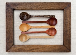 Wooden spoon collection in wooden frame