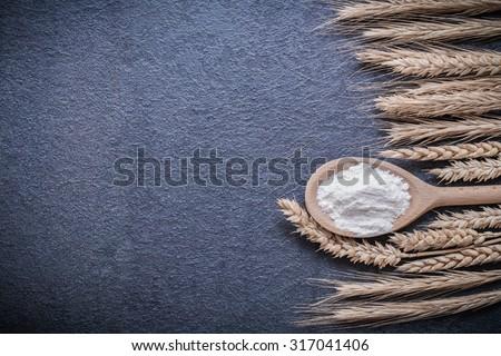 Wooden spoon flour wheat rye ears horizontal version.