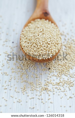 Wooden spoon of quinoa grain