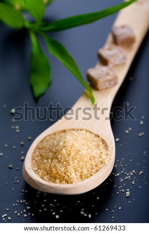 Wooden spoon with brown sugar