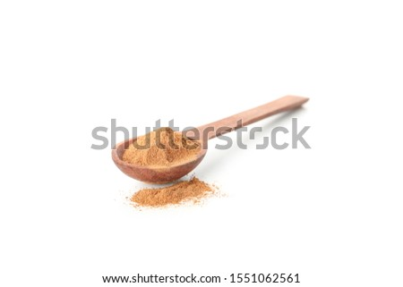 Wooden spoon with cinnamon powder isolated on white background #1551062561