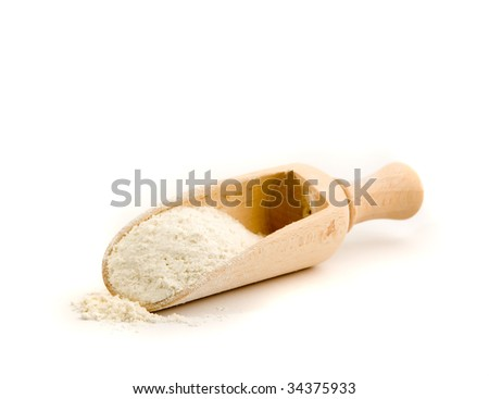 Wooden spoon with flour - stock photo