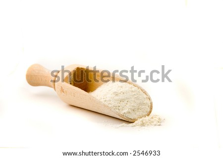 Wooden spoon with flour in it