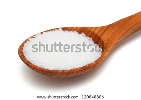 wooden spoon with salt over white