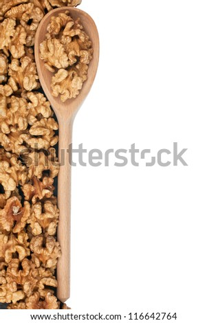 Wooden spoon with walnut  isolated on white background with space for text