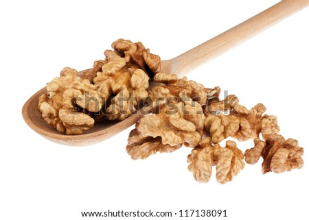 Wooden spoon with walnut, isolation on a white background