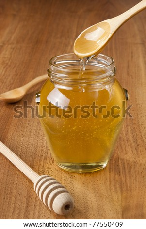 wooden spoon with wild honey