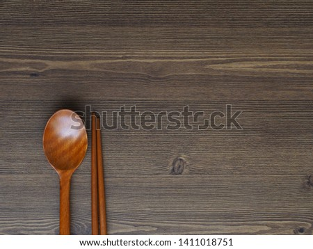 Wooden spoon, Wooden chopsticks and Wooden board background  #1411018751