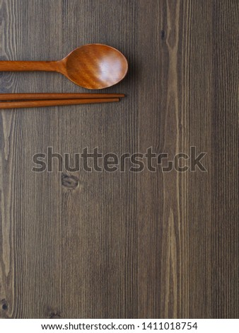 Wooden spoon, Wooden chopsticks and Wooden board background  #1411018754