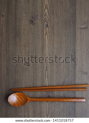 Wooden spoon, Wooden chopsticks and Wooden board background  #1411018757