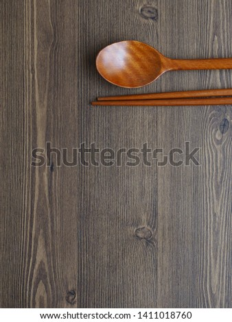 Wooden spoon, Wooden chopsticks and Wooden board background  #1411018760