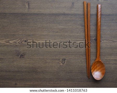 Wooden spoon, Wooden chopsticks and Wooden board background  #1411018763