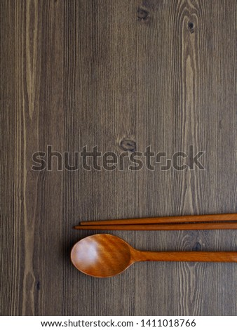 Wooden spoon, Wooden chopsticks and Wooden board background  #1411018766