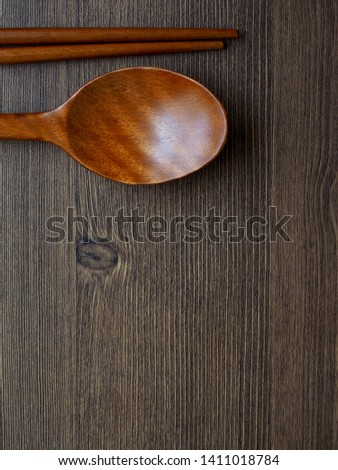 Wooden spoon, Wooden chopsticks and Wooden board background  #1411018784