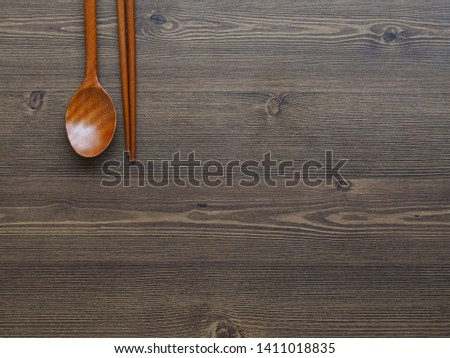 Wooden spoon, Wooden chopsticks and Wooden board background  #1411018835