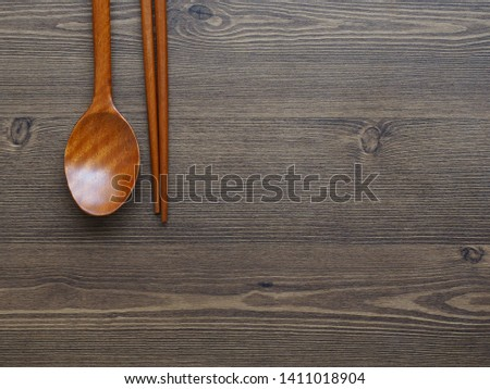 Wooden spoon, Wooden chopsticks and Wooden board background
