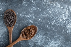 Wooden spoons of chocolate chips and coffee beans