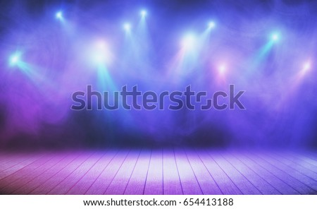 Wooden stage with blue smoke and spot lights. Presentation concept #654413188
