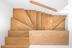 wooden stair to second floor in clean house