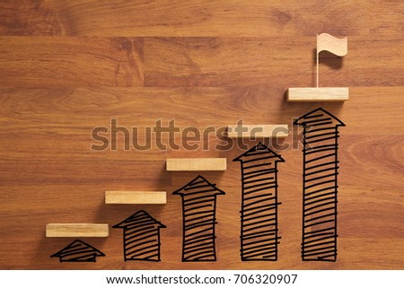 wooden staircase to reach goal and winning flag with increase graph and arrow, successful