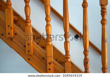 Wooden staircase to the second floor carved balusters