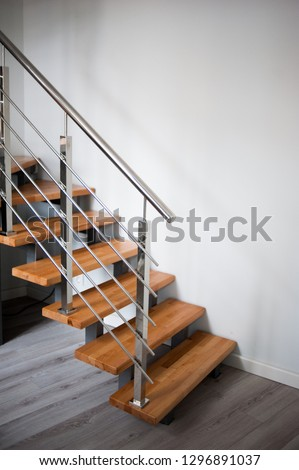 Wooden stairs and metal handrail #1296891037