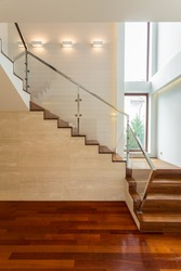 Wooden stairs and parquet in luxury apartment