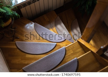 wooden stairs down light brown stock photo