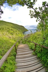 Wooden stairs leading to a trail and scenic viewpoint above Tagus Cove, Isabela Island, Galapagos, Ecuador, taken with a fisheye lens