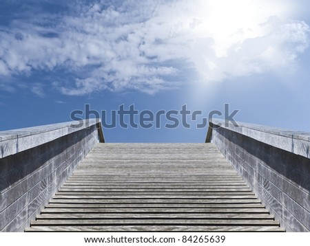 Wooden stairs leading up to a beautiful cloudy sky